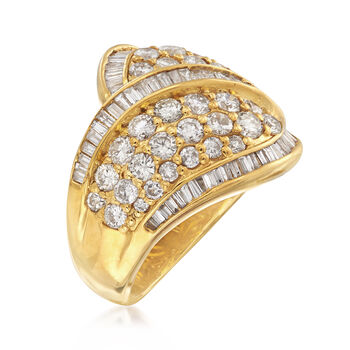 C. 1980 Vintage 3.50 ct. t.w. Round and Baguette Diamond Crossover Ring in 18kt Gold. Size 6.5
