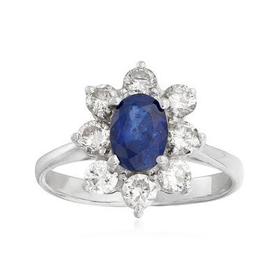 C. 1990 Vintage 1.03 Carat Sapphire and .79 ct. t.w. Diamond Flower Ring in Platinum