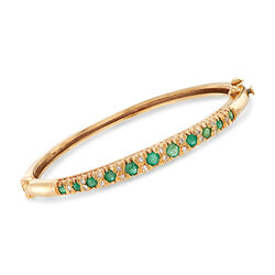 "C. 1970 Vintage 1.25 ct. t.w. Emerald and .25 ct. t.w. Diamond Bangle Bracelet in 4kt Yellow Gold. 7"", , default"