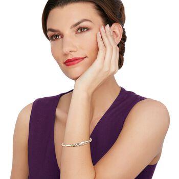 """C. 1980 Vintage 1.10 ct. t.w. Baguette Diamond Braid Bangle Bracelet in 10kt Yellow Gold. 7"""", , default"""