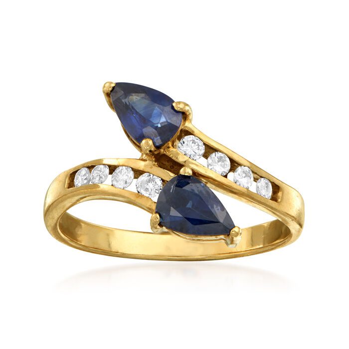 C. 1980 Vintage .95 ct. t.w. Sapphire and .20 ct. t.w. Diamond Bypass Ring in 14kt Yellow Gold. Size 6.5, , default
