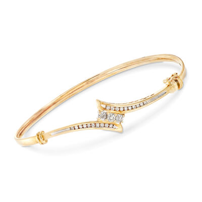 C. 1990 Vintage .55 ct. t.w. Diamond Bypass Bangle Bracelet in 14kt Yellow Gold