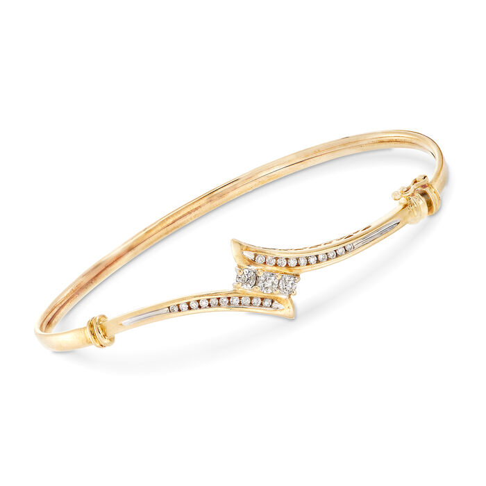 """C. 1990 Vintage .55 ct. t.w. Diamond Bypass Bangle Bracelet in 14kt Yellow Gold. 7"""""""