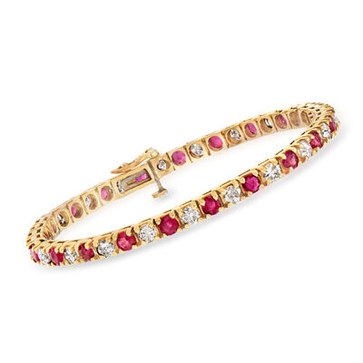 C. 1980 Vintage 4.20 ct. t.w. Ruby and 3.50 ct. t.w. Diamond Line Bracelet in 14kt Yellow Gold