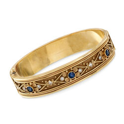 C. 1980 Vintage .90 ct. t.w. Sapphire and .70 ct. t.w. Diamond Scroll Bangle Bracelet in 18kt Yellow Gold, , default