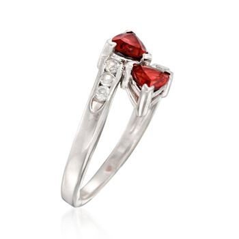 1.10 ct. t.w. Garnet and .10 ct. t.w. White Topaz Bypass Ring in Sterling Silver