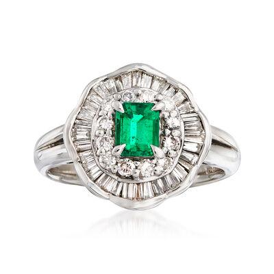 C. 1990 Vintage .39 Carat Emerald and .83 ct. t.w. Diamond Ring in Platinum