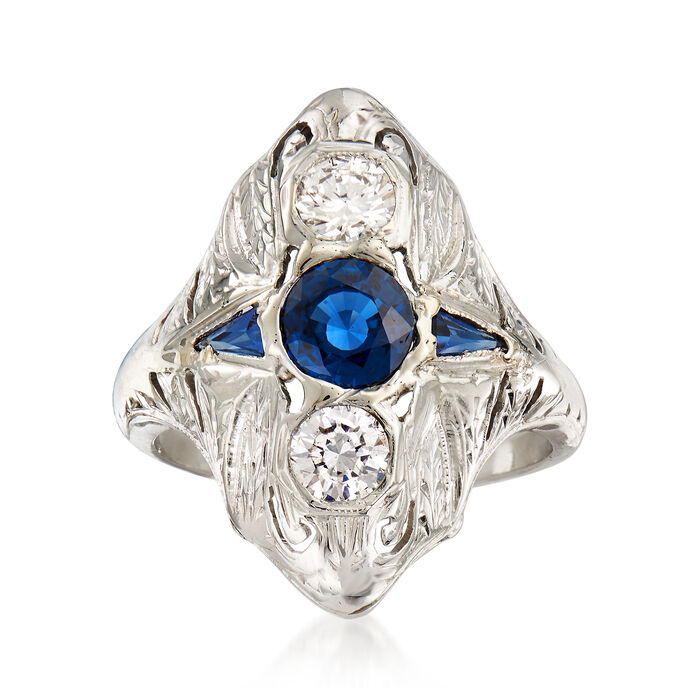 C. 1990 Vintage .60 Carat Sapphire and .40 ct. t.w. Diamond Ring with Synthetic Sapphire Accents in 18kt White Gold. Size 5