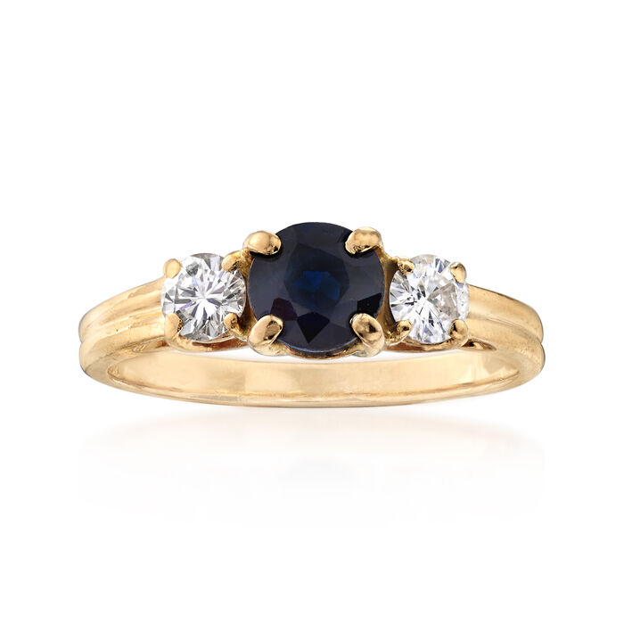 C. 1980 Vintage .75 Carat Sapphire and .40 ct. t.w. Diamond Three-Stone Ring in 14kt Yellow Gold. Size 6.5, , default
