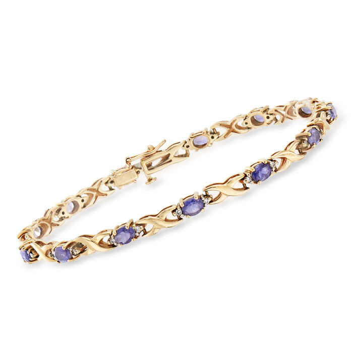 """C. 1990 Vintage 1.95 ct. t.w. Iolite and .20 ct. t.w. Diamond Bracelet in 14kt Yellow Gold. 6.75"""""""