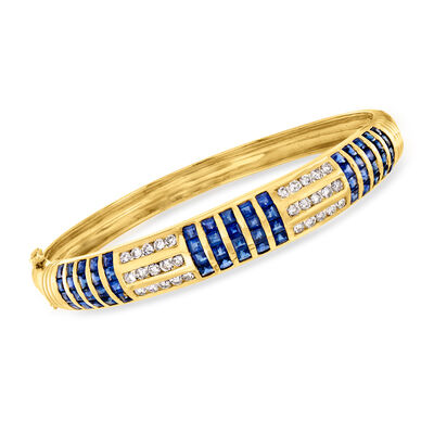 C. 1980 Vintage 6.00 ct. t.w. Sapphire and 1.35 ct. t.w. Diamond Bangle Bracelet in 18kt Yellow Gold