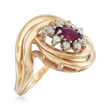 C. 1980 Vintage .25 Carat Ruby and .20 ct. t.w. Diamond Swirl Ring in 14kt Yellow Gold. Size 6.5