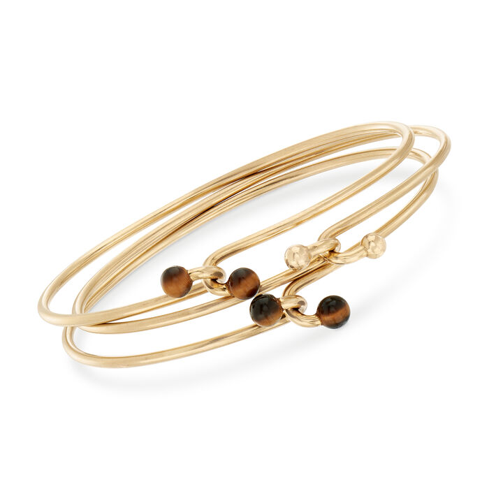 """C. 1980 Vintage Tiffany Jewelry Tiger's Eye Bangle Trio in 14kt Yellow Gold. 7.5"""""""