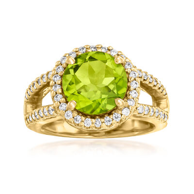 C. 1980 Vintage 3.25 Carat Peridot and .65 ct. t.w. Diamond Ring in 14kt Yellow Gold