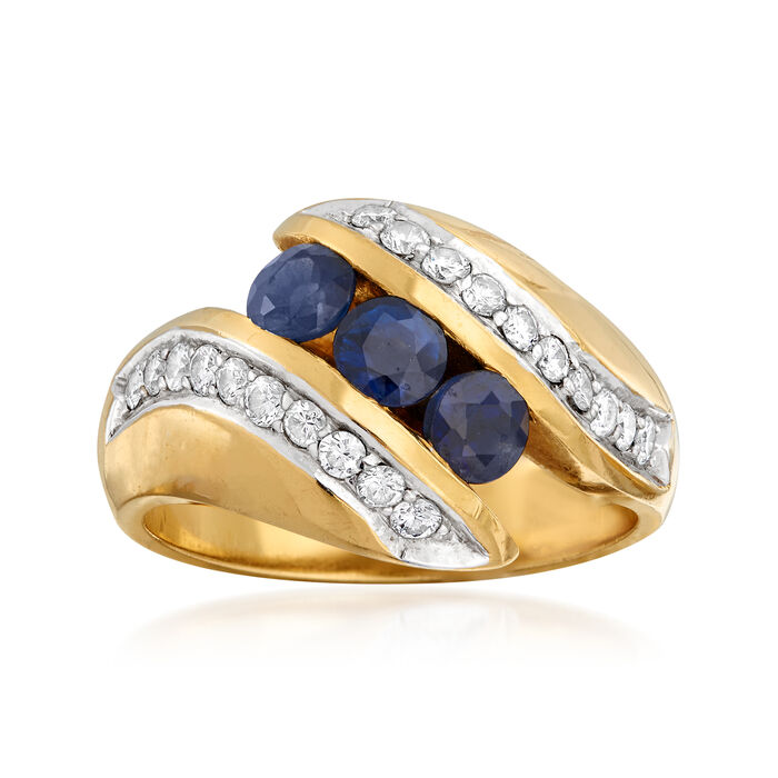 C. 1980 Vintage .90 ct. t.w. Sapphire and .50 ct. t.w. Diamond Bypass Ring in 18kt Yellow Gold
