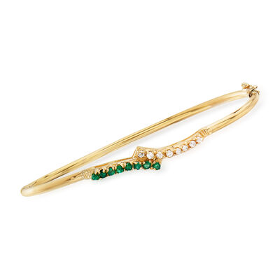 C. 1980 Vintage .25 ct. t.w. Emerald and .20 ct. t.w. Diamond Bangle Bracelet in 14kt Yellow Gold
